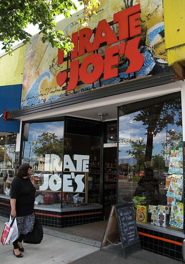 A shopper walks past the Pirate Joe's market in the Kitsilano neighborhood of Vancouver, B.C. on Wednesday, July 24, 2013. Mike Hallatt opened the shop, which resells Trader Joe's products, in 2012 and is now being sued by California-based Trader Joe's. Hallatt makes frequent trips to the United States to stock up on product during shopping sprees at Trader Joe's despite having his photo posted at most locations in Washington state. Photo: Paul Chinn, The Chronicle