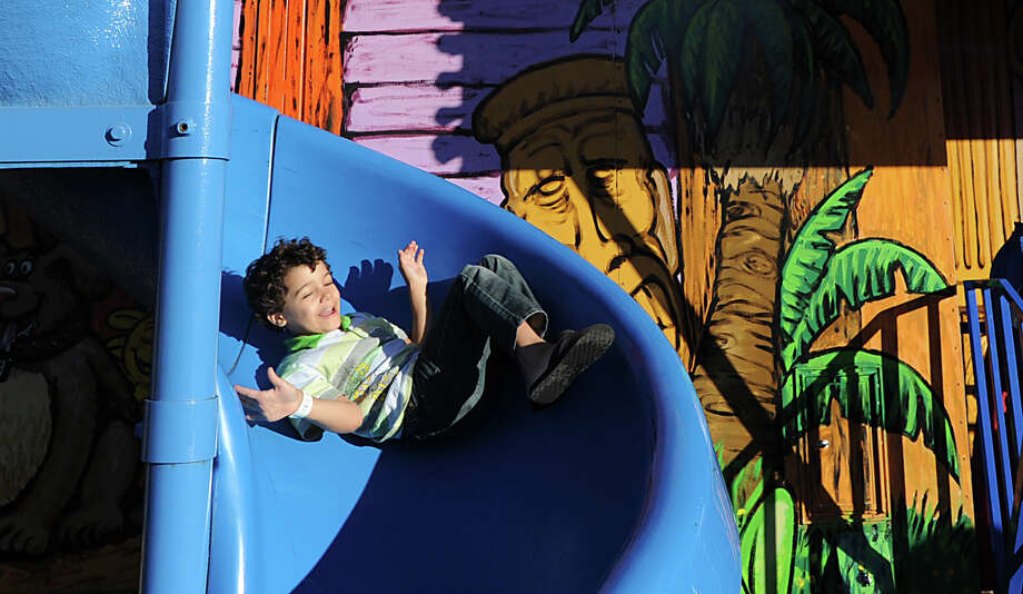 Jaden Jones, 5, of Norwalk, on an amusement ride during the annual Carnival of Fun at St. Catherine of Siena Church in Riverside, Wednesday night, August 14, 2013, celebrating the 100th Anniversary of the Parish. Photo: Bob Luckey / Greenwich Time