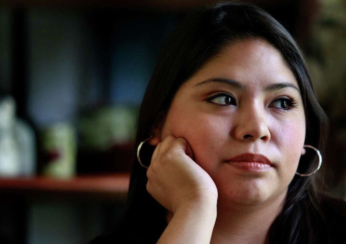 """Carina Quevedo, 22, grew up in Houston after being brought across the Rio Grande as an infant by her uncle. """"It's finally like I don't have to hide,"""" she says."""