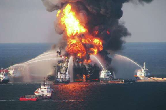 Fire boats battle a fire at the off shore oil rig Deepwater Horizon April 21, 2010 in the Gulf of Mexico off the coast of Louisiana. Multiple Coast Guard helicopters, planes and cutters responded to rescue the Deepwater Horizons 126 person crew after an explosion and fire caused the crew to evacuate.  (Photo by U.S. Coast Guard via Getty Images)