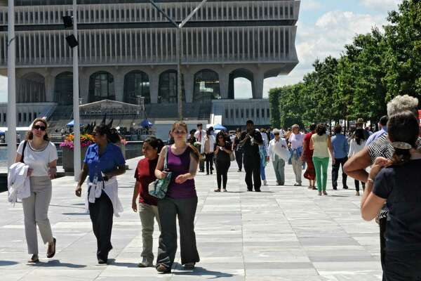 The nice weather brought people outside during their lunch hour at the Empire State Plaza Wednesday, Aug. 14, 2013, in Albany, N.Y. (Lori Van Buren / Times Union)