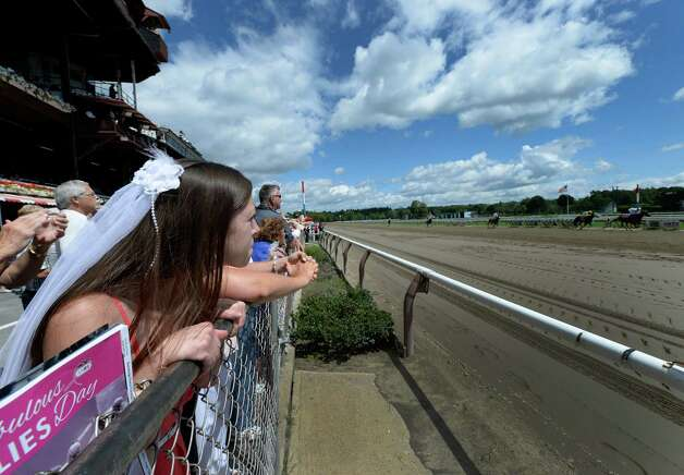 Bride-to-be, Heather LaMountain of New Lebanon enjoys the beautiful weather as she celebrates her bachelorette party Wednesday, Aug 14, 2013, at Saratoga Race Course in Saratoga Springs, N.Y.  (Skip Dickstein/Times Union) Photo: SKIP DICKSTEIN