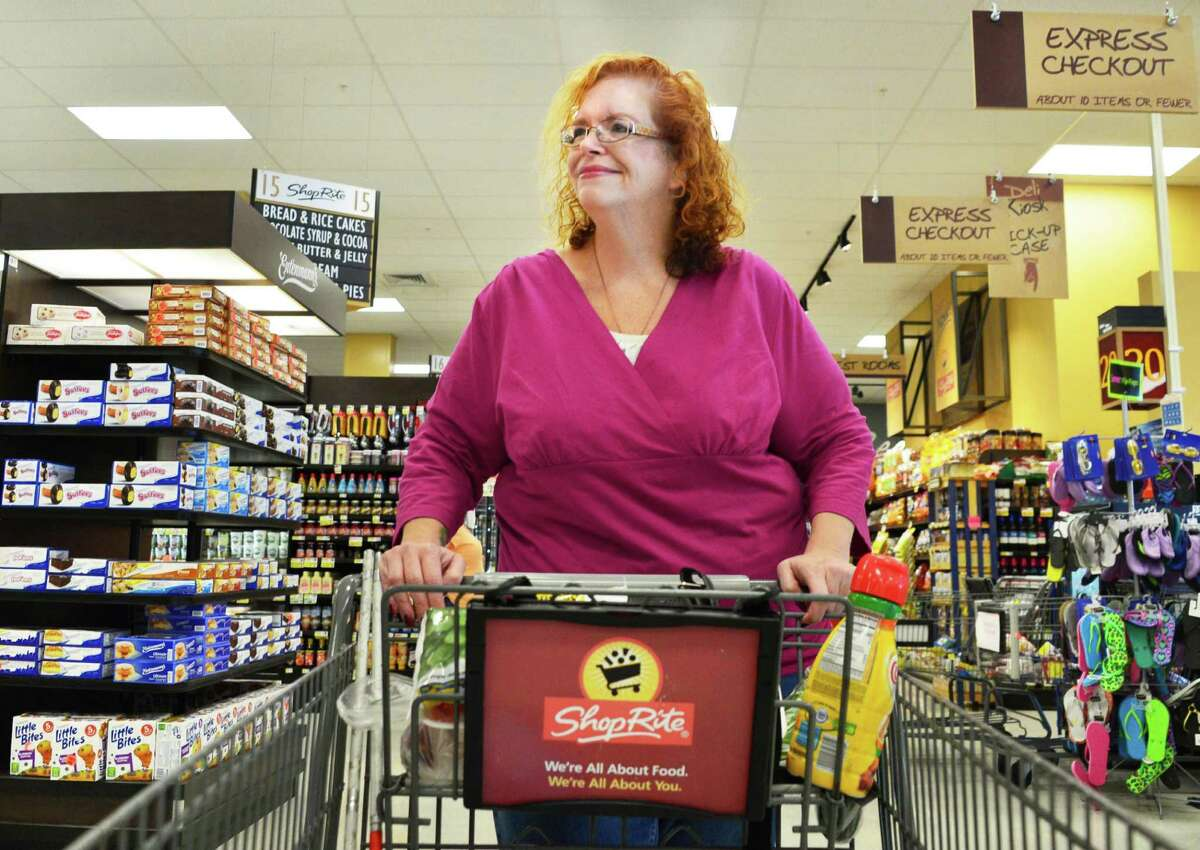Robbin Dzembo of Rensselaer shops fro groceries at the ShopRite grocery store on Central Avenue Monday, Aug. 12, 2013, in Albany, N.Y. (John Carl D'Annibale / Times Union)