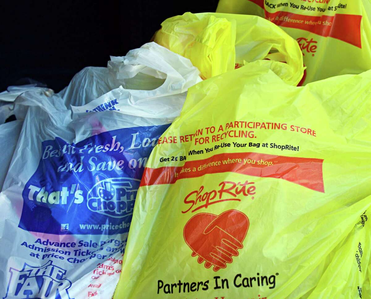 Price Chopper, left, and Shop Rite shopping bags fill the trunk asRobbin Dzembo of Rensselaer Monday, Aug. 12, 2013, following a grocery shopping trip in Albany, N.Y. (John Carl D'Annibale / Times Union)