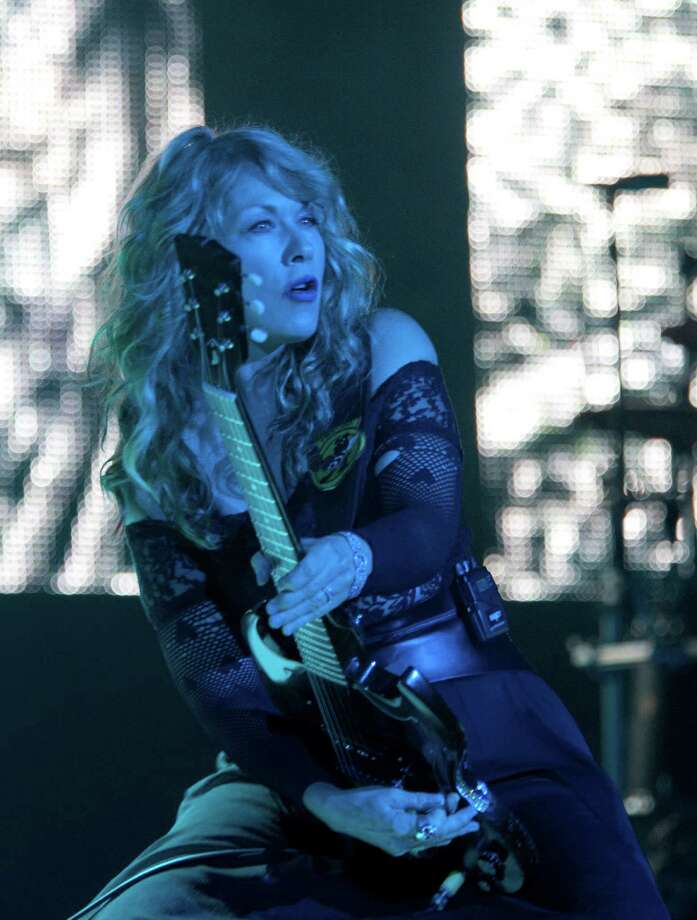 Guitarist Nancy Wilson from the band Heart performs at the Cynthia Woods Mitchell Pavilion Wednesday, Aug. 14, 2013, in The Woodlands. Photo: Johnny Hanson, Houston Chronicle / © 2013  Houston Chronicle