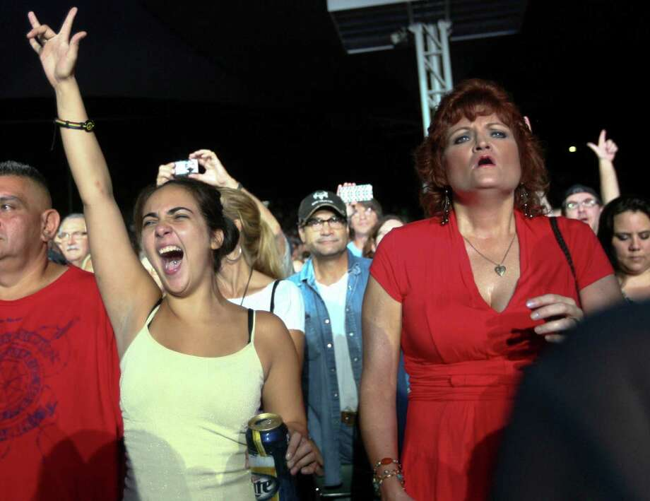 Christina Linn, left, watches the band Heart perform at the Cynthia Woods Mitchell Pavilion Wednesday, Aug. 14, 2013, in The Woodlands. Photo: Johnny Hanson, Houston Chronicle / © 2013  Houston Chronicle