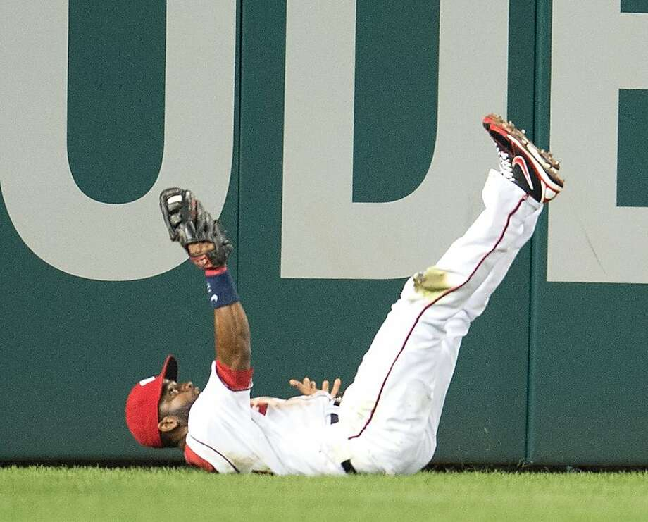 Denard Span ran, dived and caught Hunter Pence's long drive to center to end the Giants' hopes for a comeback win. Photo: Harry E. Walker, McClatchy-Tribune News Service