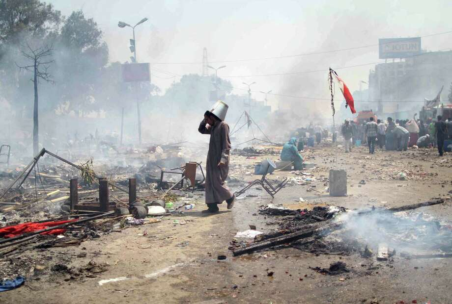 A backer of ousted Egyptian President Mohamed Morsi walks through debris left by clashes with police in Cairo. Photo: Mosaab El-Shamy / AFP / Getty Images