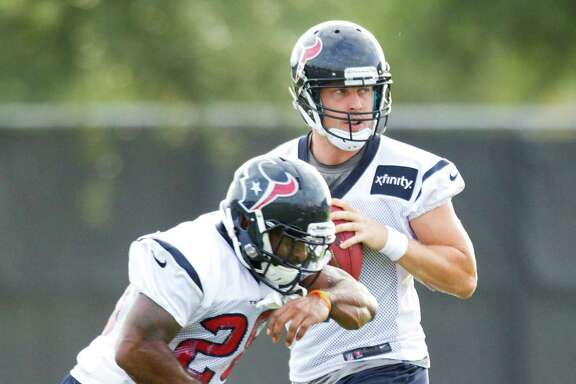 After faking a handoff to Dennis Johnson, Case Keenum, right, drops back to pass in Wednesday's practice. He will get a big chance to show his stuff Saturday.