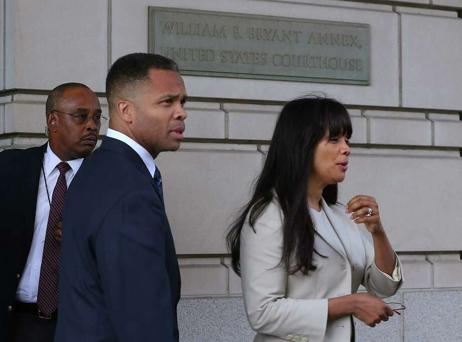 Former Rep. Jesse Jackson Jr. and wife Sandi leave the courthouse after being sentenced. Photo: Mark Wilson, Getty Images