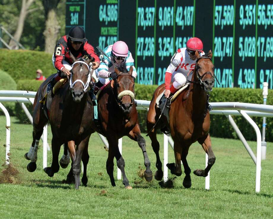 Balance the Books, right,  with jockey Javier Castellano, sneaks up on the inside rail to win the Stroll Stakes race Wednesday afternoon, Aug. 14, 2013, at Saratoga Race Course in Saratoga Springs, N.Y.   (Skip Dickstein/Times Union) Photo: SKIP DICKSTEIN