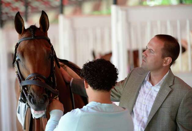 Trainer Chad Brown watches his charge Balance the Books before staringthe Stroll Stakes race Wednesday, Aug. 14, 2013 at Saratoga Race Course in Saratoga Springs, N.Y. Balance the Book was ridden to victory by Javier Castellano. (Skip Dickstein/Times Union) Photo: SKIP DICKSTEIN