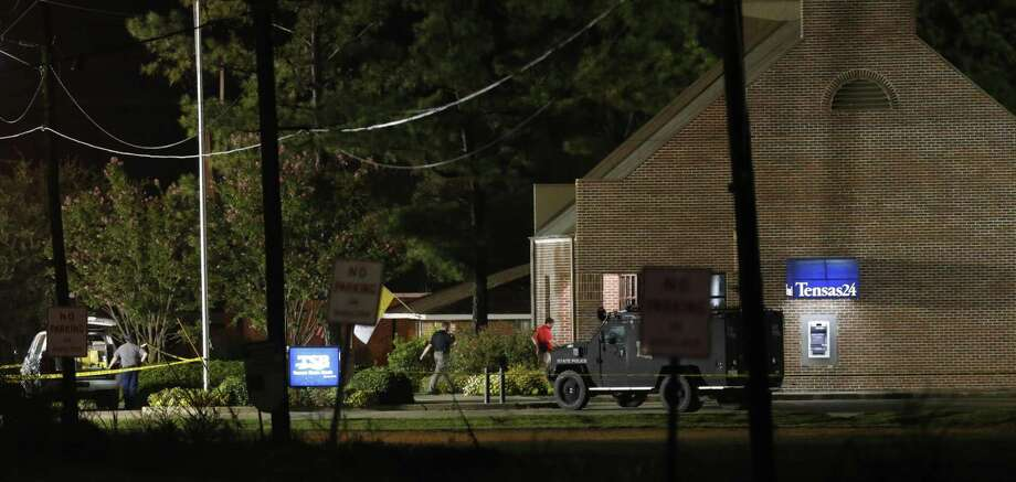 Investigators work at the scene of a bank hostage situation in St. Joseph, La. Fuaed Abdo Ahmed shot two hostages, killing one, before being shot and killed by police. Photo: Rogelio V. Solis / Associated Press