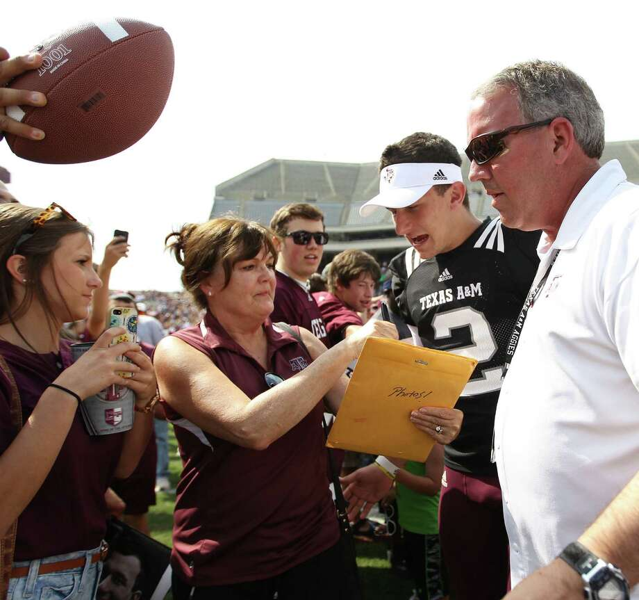 The eligibility of A&M quarterback Johnny Manziel (2) could be jeopardized depending on the results of an investigation by the NCAA into whether he was paid to sign autographs. Photo: Karen Warren / Houston Chronicle