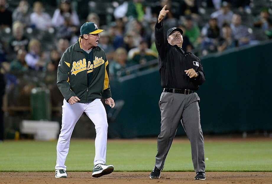 Umpire Doug Eddings ejects A's manager Bob Melvin at the end of the eighth. Photo: Thearon W. Henderson, Getty Images