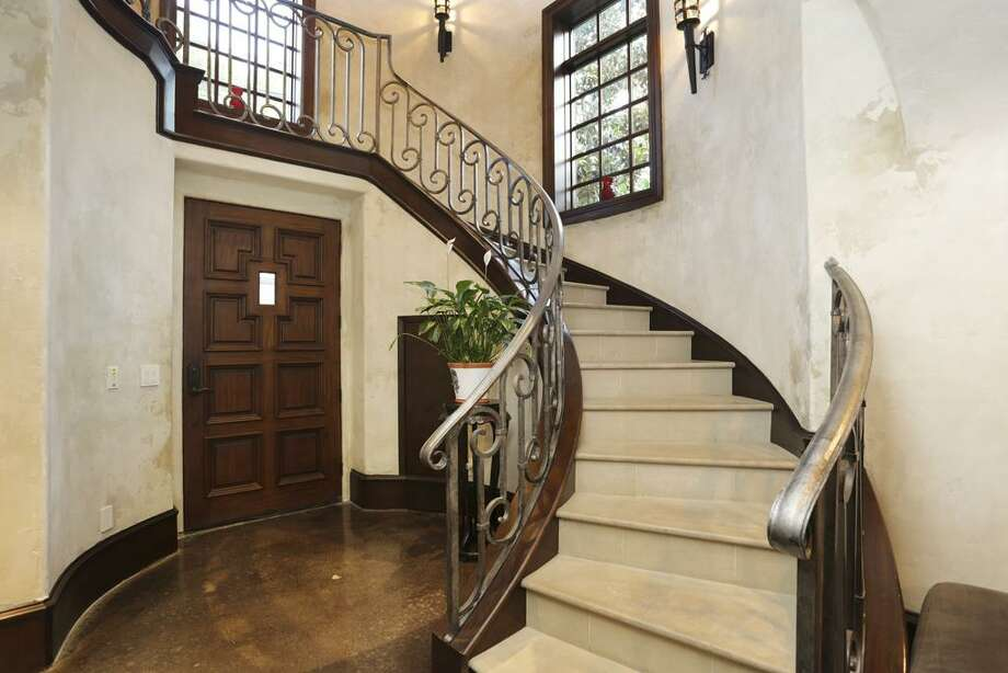 Foyer - solid entry door, wrought iron hand rail, slab travertine steps, coat closet.
