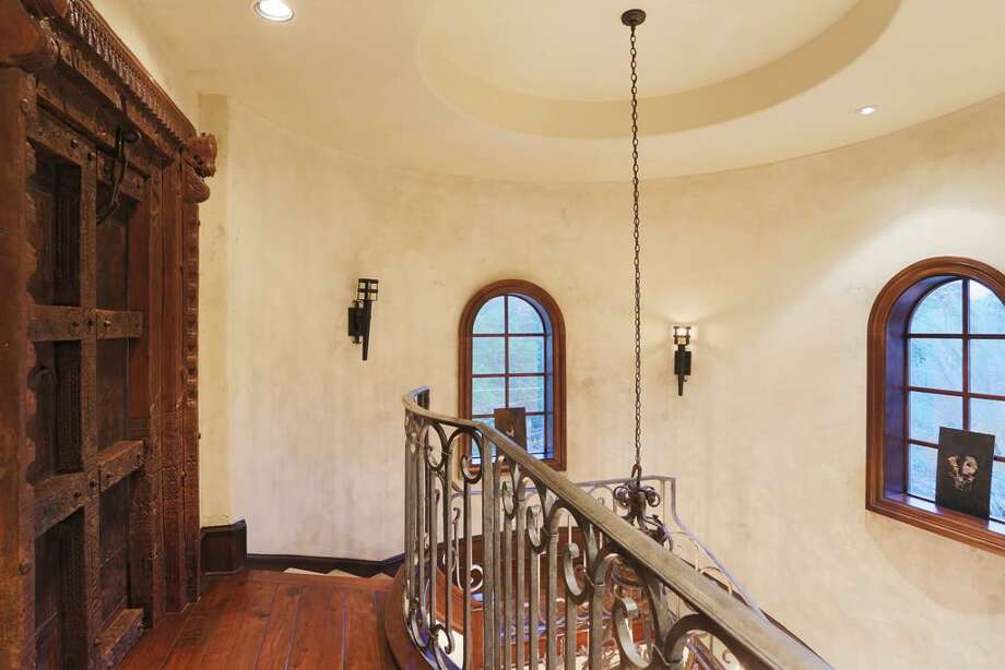 Third floor landing - antique double doors to guest bedroom.