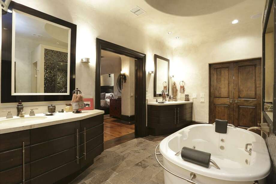 Master Bath - double vanities, walk-in closet, two separate water closets, stone tile floor.