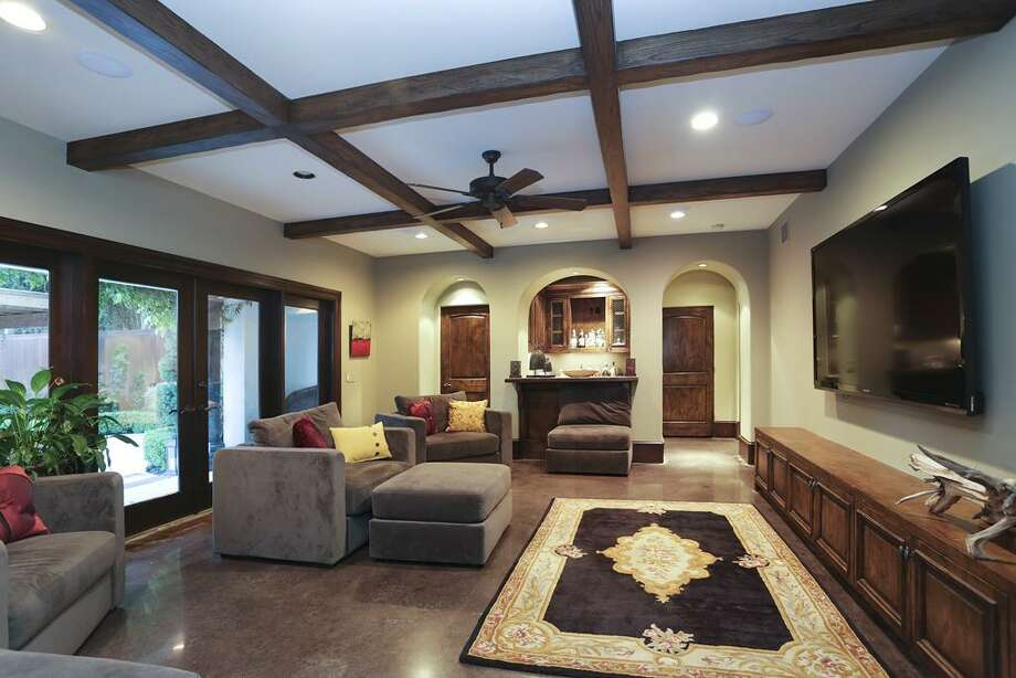 Media room - arched doorways to full bath, bar / elevator, and exercise room.