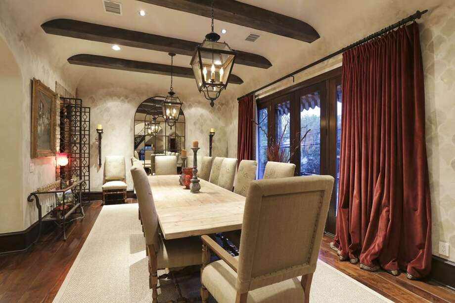Dining room - exposed beams, antique light fixtures, coved ceiling, Venetian plaster walls, solid walnut hardwood floors.