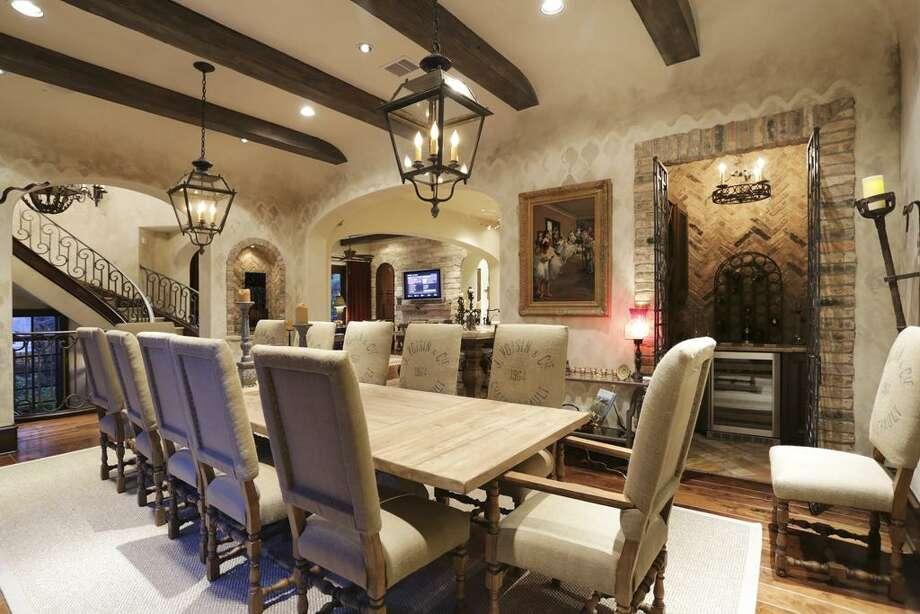 Dining room with wine bar, art lighting.