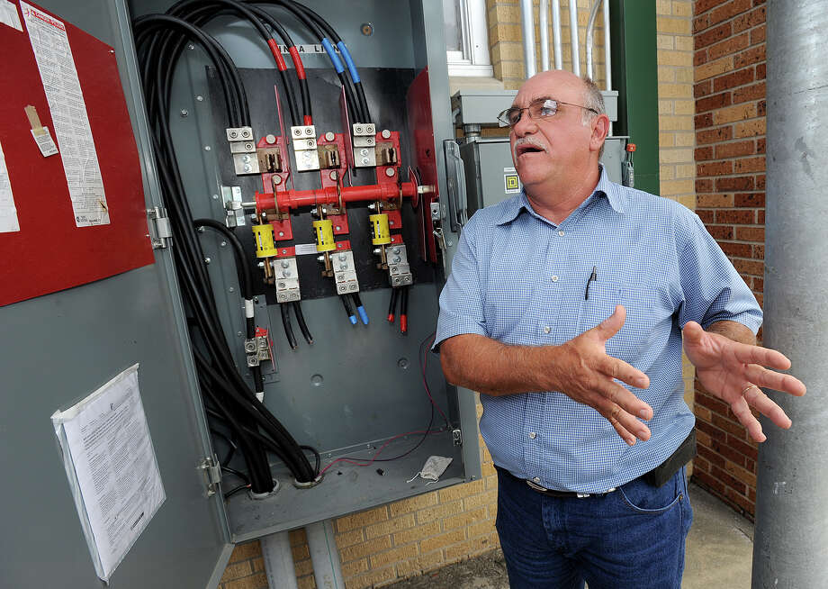 District employees say several hundred pounds of copper wiring has been stolen from four Beaumont Schools within the past several weeks. Robert Mann BISD maintenance worker shows the air conditioning unit at Bingman Blanchette Elementary School where the latest robbery occurred Tuesday night. BISD officials say they are working to have the repairs made by the first day of school.  Photo taken Wednesday, August 14, 2013 Guiseppe Barranco/The Enterprise Photo: Guiseppe Barranco, STAFF PHOTOGRAPHER / The Beaumont Enterprise