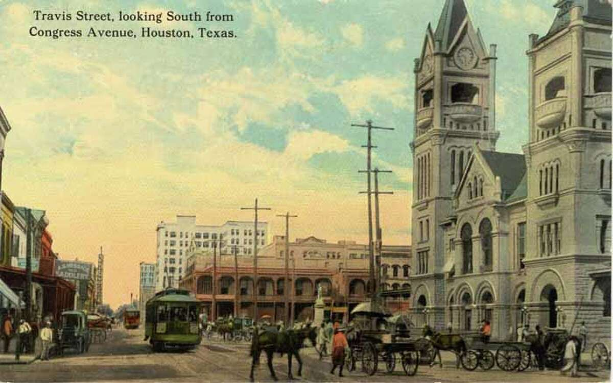 HOUSTON - 1911: Vintage postcard looking south on Travis Street in Houston. (Photo by Lake County Museum/Getty Images)