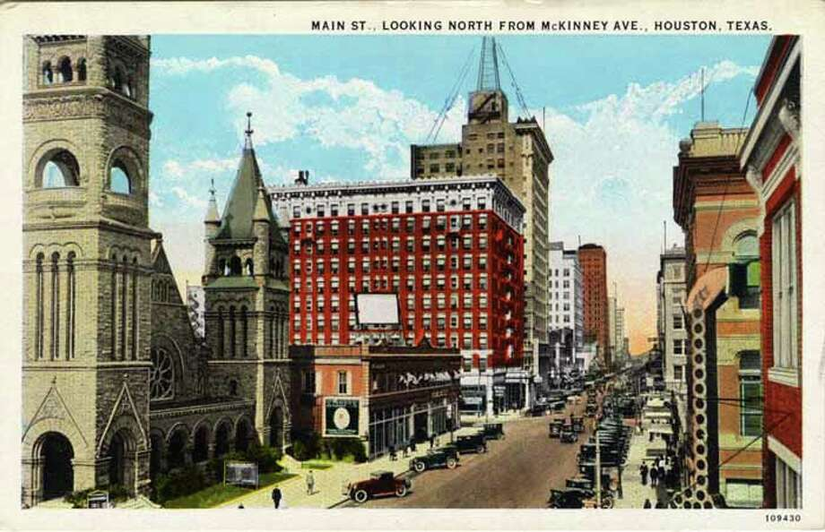 HOUSTON - 1926:  Vintage postcard showing a view sown MainStreet The street is lined with a church, low buildings and skyscrapers The street is filled with traffic and parked cars. (Photo by Lake County Museum/Getty Images) Photo: Curt Teich Postcard Archives, Getty Images / Archive Photos