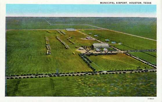 HOUSTON - 1928:  Vintage postcard showing an aerial view of the Houston Municipal Airport surrounded by fields. (Photo by Lake County Museum/Getty Images) Photo: Curt Teich Postcard Archives, Getty Images / Archive Photos