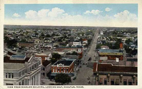 HOUSTON - 1911:  Vintage postcard showing a view down a Houston street from the Scanlon Building. (Photo by Lake County Museum/Getty Images) Photo: Curt Teich Postcard Archives, Getty Images / Archive Photos