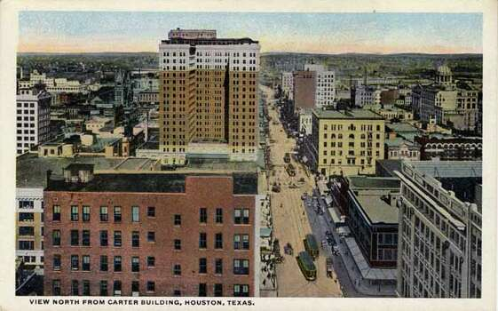 HOUSTON - 1918:  Vintage postcard showing a bird's eye view of the downtown business district of Houston from the Carter Building looking north There is traffic on the street below. (Photo by Lake County Museum/Getty Images) Photo: Curt Teich Postcard Archives, Getty Images / Archive Photos
