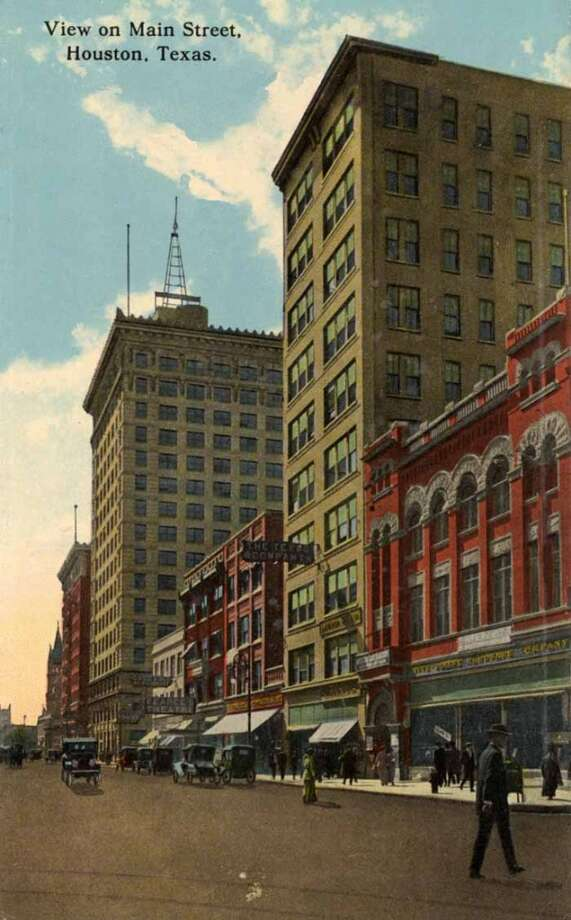 HOUSTON - 1918:  Vintage postcard showing a view on Main Street Storefronts and building facades are visible Vintage automobiles and pedestrians are on the street. (Photo by Lake County Museum/Getty Images) Photo: Curt Teich Postcard Archives, Getty Images