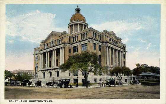HOUSTON - 1918:  Vintage postcard showing the exterior of the County Court House Vintage automobiles surround the structure and a streetcar is visible on the right . (Photo by Lake County Museum/Getty Images) Photo: Curt Teich Postcard Archives, Getty Images / Archive Photos