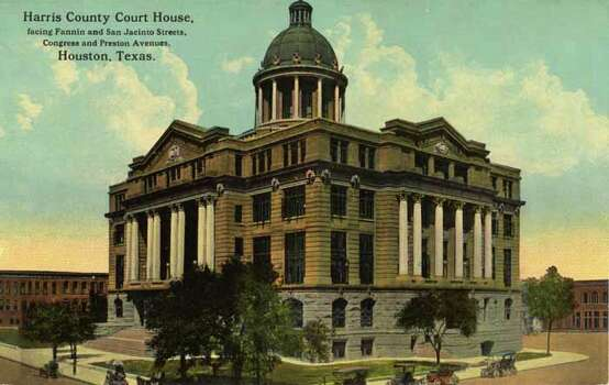 HOUSTON - 1911:  Vintage postcard showing the exterior of the Harris County Court House and a portion of the surrounding streets. (Photo by Lake County Museum/Getty Images) Photo: Curt Teich Postcard Archives, Getty Images / Archive Photos