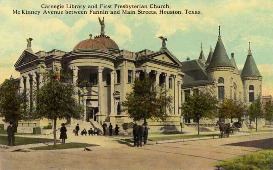 HOUSTON - 1911:  Vintage postcard showing the Carnegie Library and First Presbyterian Church in Houston  A small group of people are gathered outside the library. (Photo by Lake County Museum/Getty Images) Photo: Curt Teich Postcard Archives, Getty Images / Archive Photos