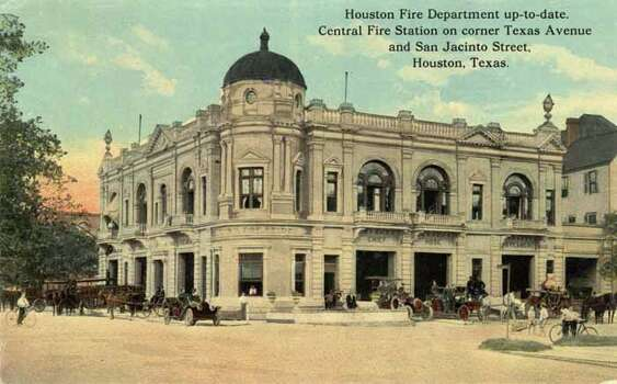 HOUSTON - 1911:  Vintage postcard showing the Houston Fire Department building with automobiles and horse-drawn fire vehicles on display. (Photo by Lake County Museum/Getty Images) Photo: Curt Teich Postcard Archives, Getty Images / Archive Photos