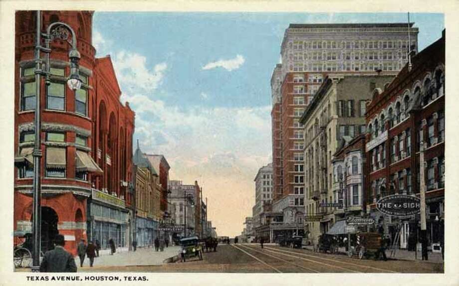 HOUSTON - 1918:  Vintage postcard showing a view down Texas Avenue  Store fronts and multi story buildings are visible  There are automobiles and pedestrians on the street. (Photo by Lake County Museum/Getty Images) Photo: Curt Teich Postcard Archives, Getty Images / Archive Photos
