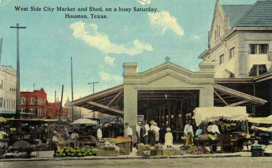 Houston, 1911: A vintage postcard shows an outdoor produce market. Photo: Curt Teich Postcard Archives, Getty Images / Archive Photos