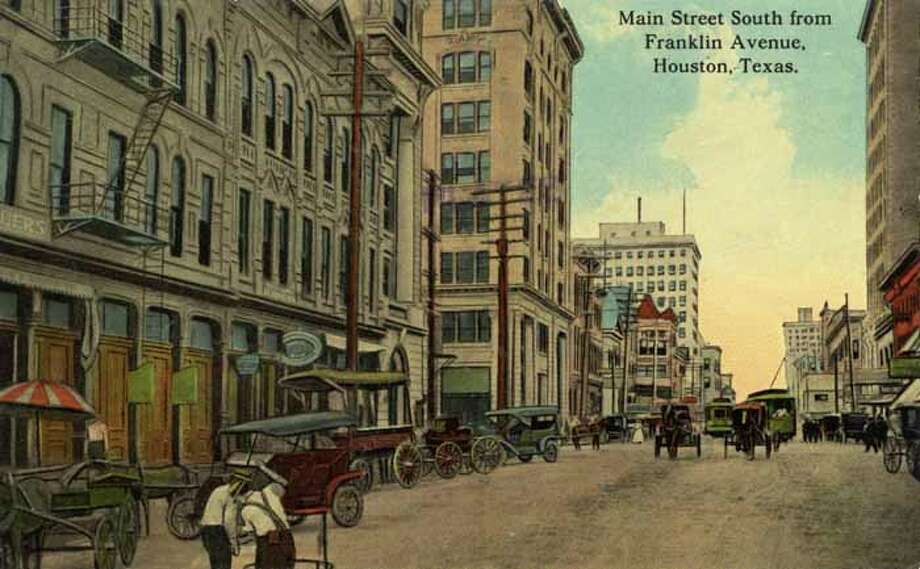 HOUSTON - 1911:  Vintage postcard looking South on Main Street  Automobiles and horse-drawn carriages line the street. (Photo by Lake County Museum/Getty Images) Photo: Curt Teich Postcard Archives, Getty Images / Archive Photos