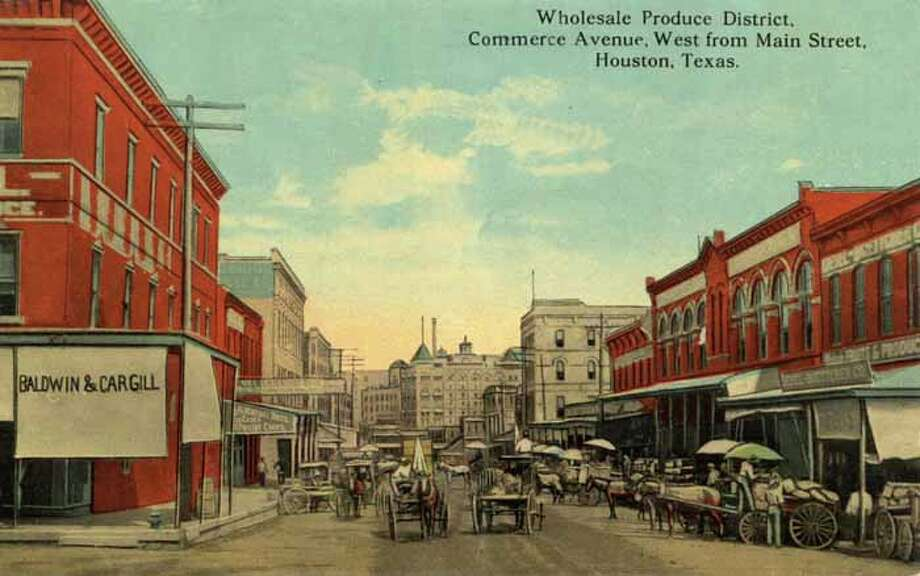 HOUSTON - 1911:  Vintage postcard showing a view down Commerce Avernue in Houston  Horse-drawn carts and carriages line the busy street. (Photo by Lake County Museum/Getty Images) Photo: Curt Teich Postcard Archives, Getty Images / Archive Photos