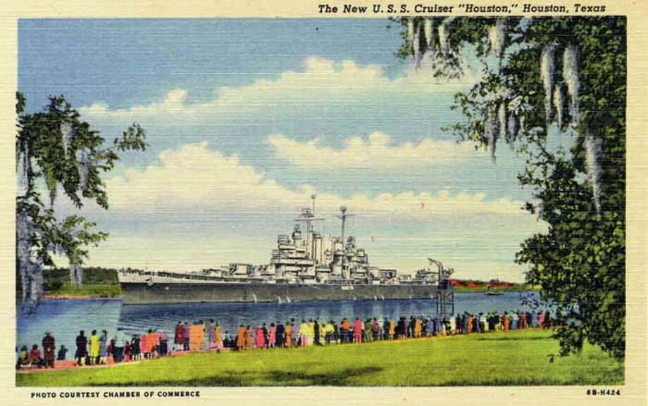 HOUSTON - 1946:  Vintage postcard showing a crowd of people standing along the shore watching a battleship. (Photo by Lake County Museum/Getty Images) Photo: Curt Teich Postcard Archives, Getty Images / Archive Photos