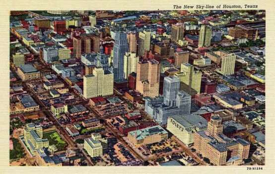 HOUSTON - 1947:  Vintage postcard showing an aerial view of the Houston skyline. (Photo by Lake County Museum/Getty Images) Photo: Curt Teich Postcard Archives, Getty Images / Archive Photos