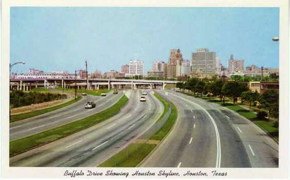 HOUSTON - 1958:  Vintage postcard showing a large, ten-lane highway and a view of the Houston skyline. (Photo by Lake County Museum/Getty Images) Photo: Curt Teich Postcard Archives, Getty Images / Archive Photos