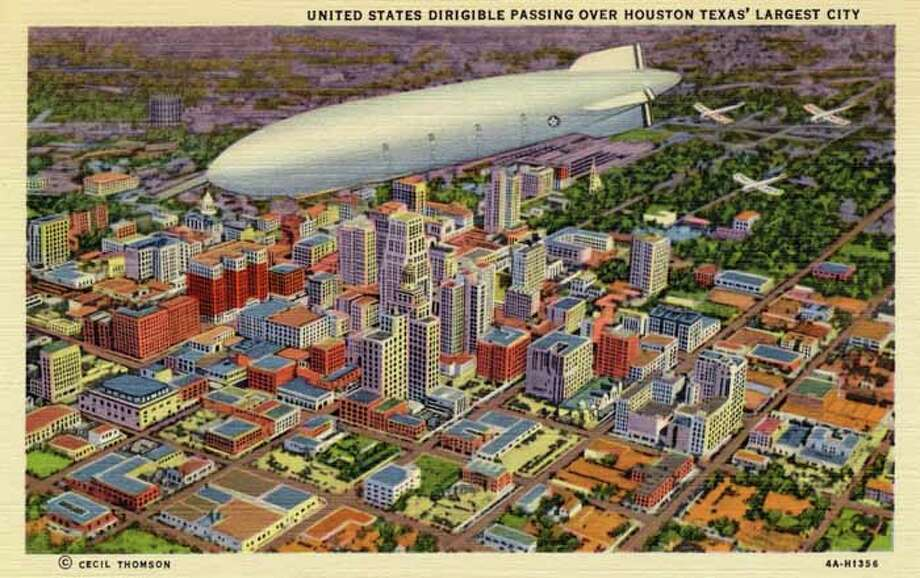 HOUSTON - 1934:  Vintage postcard showing a dirigible passing over Houston, Texas. (Photo by Lake County Museum/Getty Images) Photo: Curt Teich Postcard Archives, Getty Images / Archive Photos