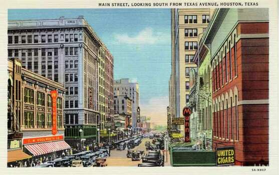 HOUSTON - 1935:  Vintage postcard showing a view looking south on Main Street in Houston. (Photo by Lake County Museum/Getty Images) Photo: Curt Teich Postcard Archives, Getty Images / Archive Photos