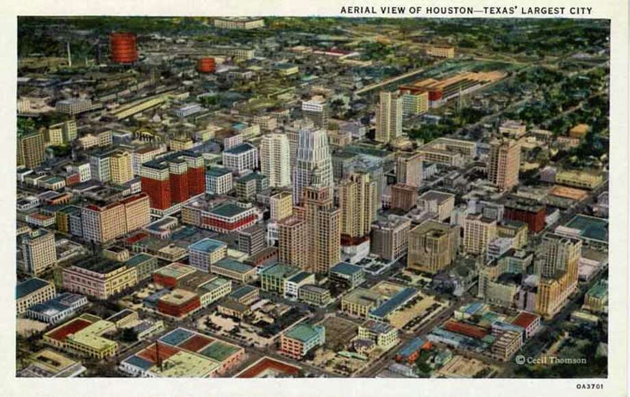 HOUSTON - 1930:  Vintage postcard showing an aerial view of downtown Houston. (Photo by Lake County Museum/Getty Images) Photo: Curt Teich Postcard Archives, Getty Images / Archive Photos