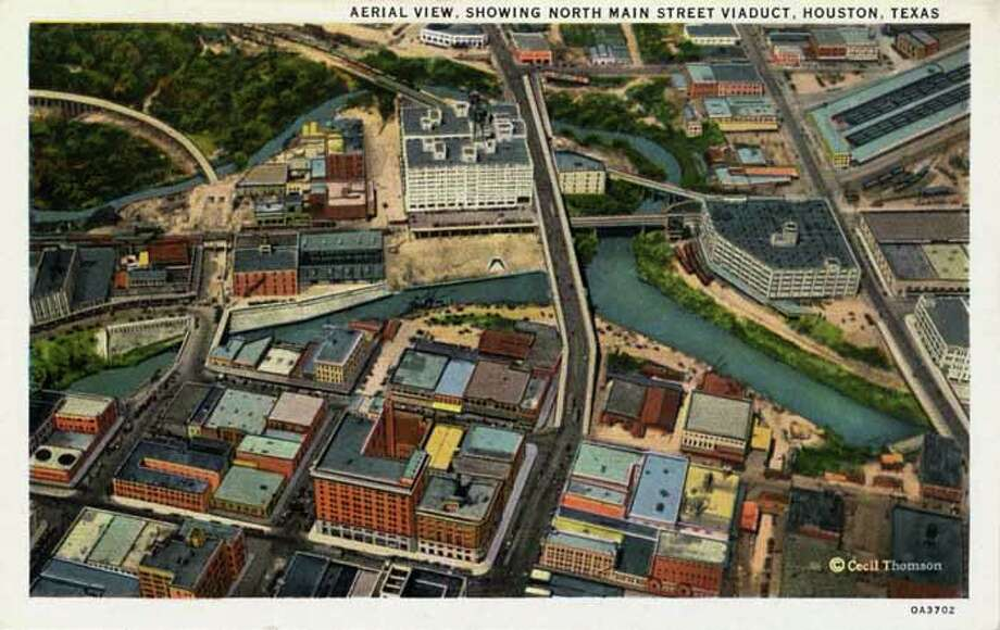 HOUSTON - 1930:  Vintage postcard showing and aerial view of the North Main Street Viaduct Many low and high rise buildings are visible. (Photo by Lake County Museum/Getty Images) Photo: Curt Teich Postcard Archives, Getty Images / Archive Photos