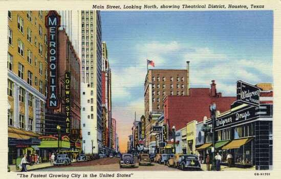 HOUSTON - 1940:  Vintage postcard showing a view down Main Street in Houston's Theater District. (Photo by Lake County Museum/Getty Images) Photo: Curt Teich Postcard Archives, Getty Images / Archive Photos