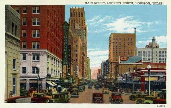 HOUSTON - 1930:  Vintage postcard showing the view looking north on Main Street Store fronts and high rise buildings line the street that is filled with vintage automobiles. (Photo by Lake County Museum/Getty Images) Photo: Curt Teich Postcard Archives, Getty Images / Archive Photos