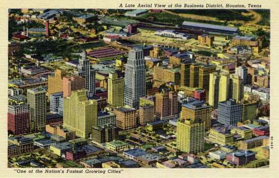 HOUSTON - 1950:  Vintage postcard showing an aerial view of the Houston business district. (Photo by Lake County Museum/Getty Images) Photo: Curt Teich Postcard Archives, Getty Images / Archive Photos